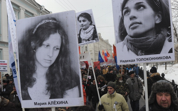 Opposition activists attend an anti-government rally in Moscow to demand the release of political prisoners, among them the still-jailed members of the female punk band Pussy Riot (Photo Credit: Andrey Smirnov/AFP/Getty Images).