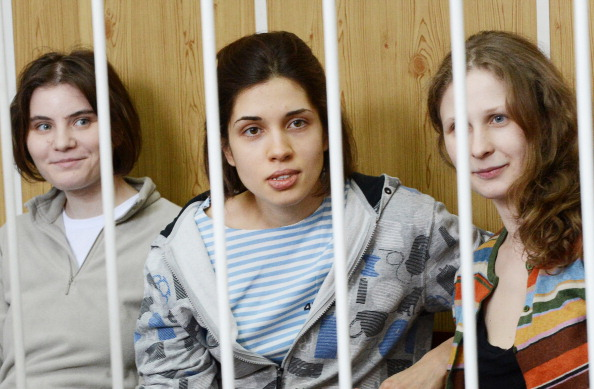 Pussy Riot members Nadya, Masha and Katya sitting behind bars during a court hearing in Moscow. Yesterday, a court in the Russian region of Perm refused to grant Masha parole. Nadya's parole hearing is tomorrow (Photo Credit: Natalia Kolesnikova/AFP/GettyImages).