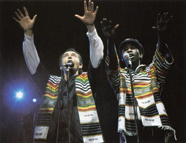 Peter Gabriel and Youssou N'Dour performing onstage at the Human Rights Now! concert (Photo Credit: Ken Regan/Neal Preston for Amnesty International).