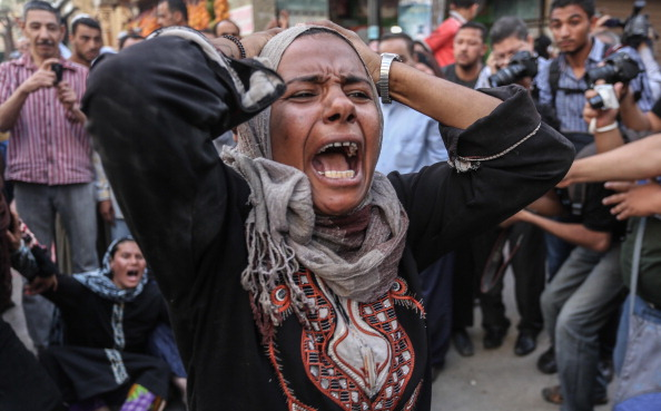 Egyptian defendants' relatives mourn after Egypt court refers 638 Morsi supporters are sentenced to death sentence in the coutnry's latest mass trial (Photo Credit: Ahmed Ismail/Anadolu Agency/Getty Images).