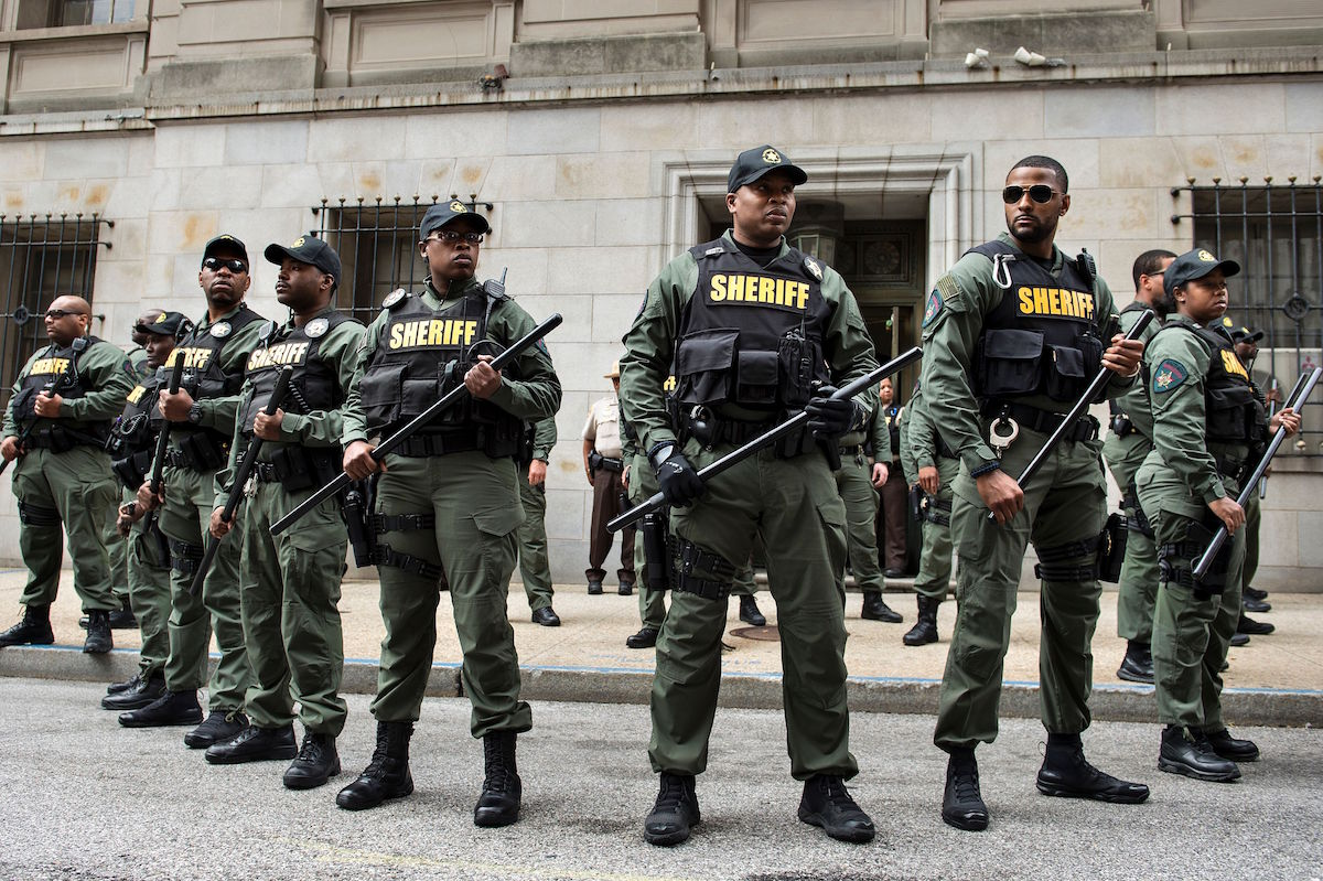 TOPSHOT - Baltimore County Sheriffs officers gather after Baltimore Officer Caesar Goodson Jr. was acquitted of all charges in his murder trial for the death of Freddie Gray at the Mitchell Court House June 23, 2016 in Baltimore, Maryland. Goodson, who drove the van in which Freddie Gray, a young African American, was transported before he died was acquitted of all charges including second degree murder and manslaughter. / AFP / Brendan Smialowski (Photo credit should read BRENDAN SMIALOWSKI/AFP/Getty Images)