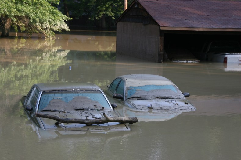 two cars underwater in flood
