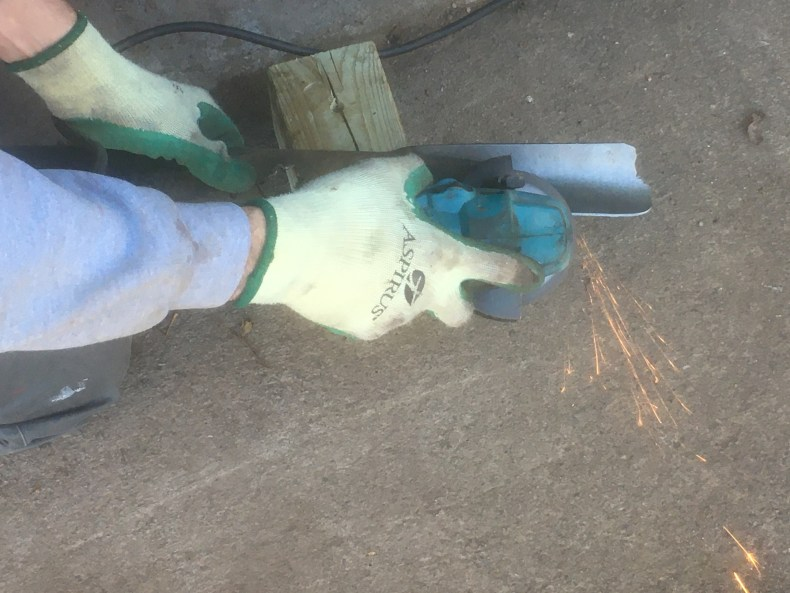 Sharpen lawnmower blade.