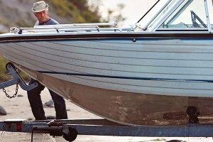 Inspecting boat hull.