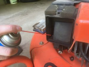 Clean the carburetor to help revive a lawnmower that won't start.