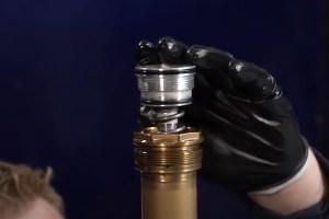 Installing compression assembly in dirt bike forks.