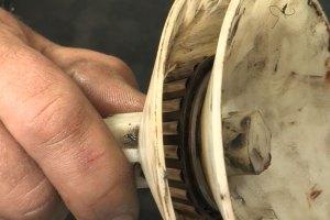 Repack a trailer bearings using a bearing tool.