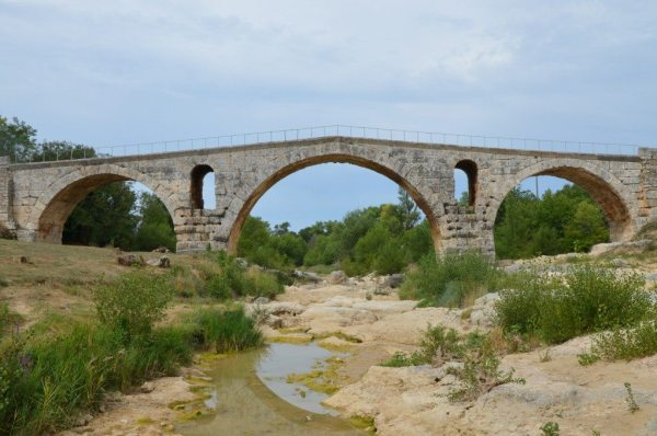 The Pont Julien, a 3 BCE Roman arch bridge over the Calavon river built on the Via Domitia © Carole Raddato