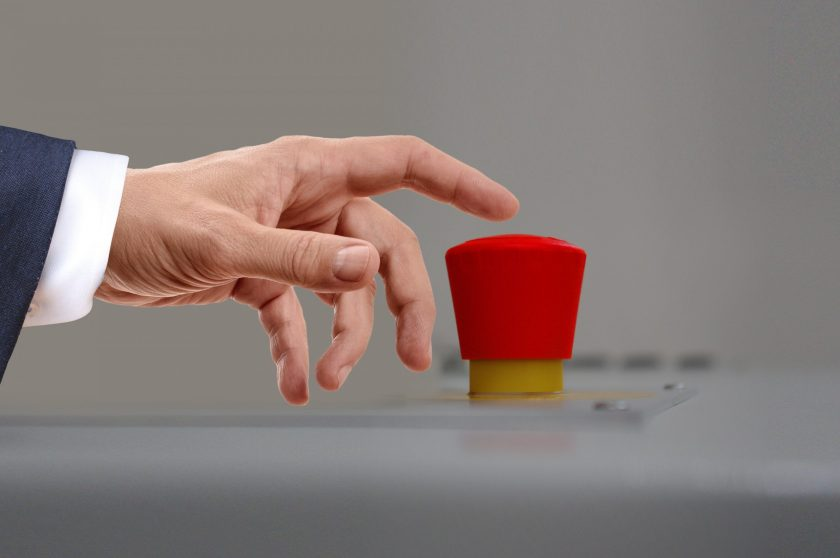 image of hand pressing big red button