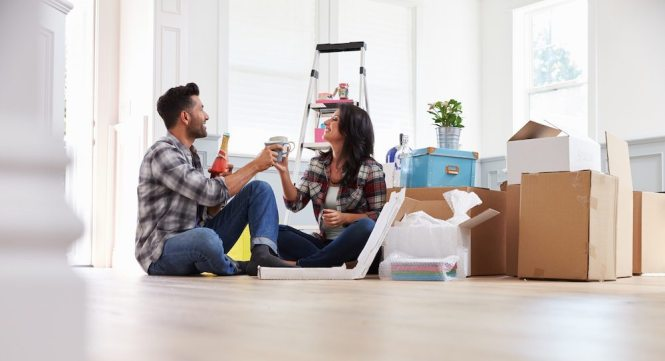 Moving Day Tips Enjoying Pizza And Beer On The Floor Of Their Empty New