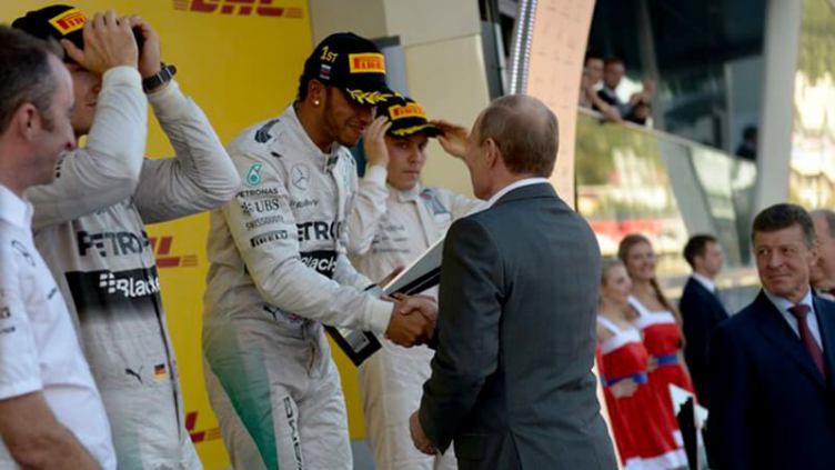 Lewis Hamilton with Vladimir Putin after winning 2014 Russian GP