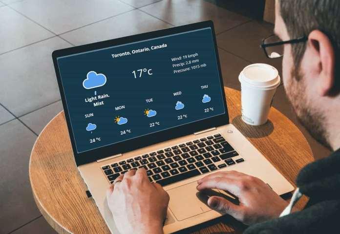A businessman using weatherstack