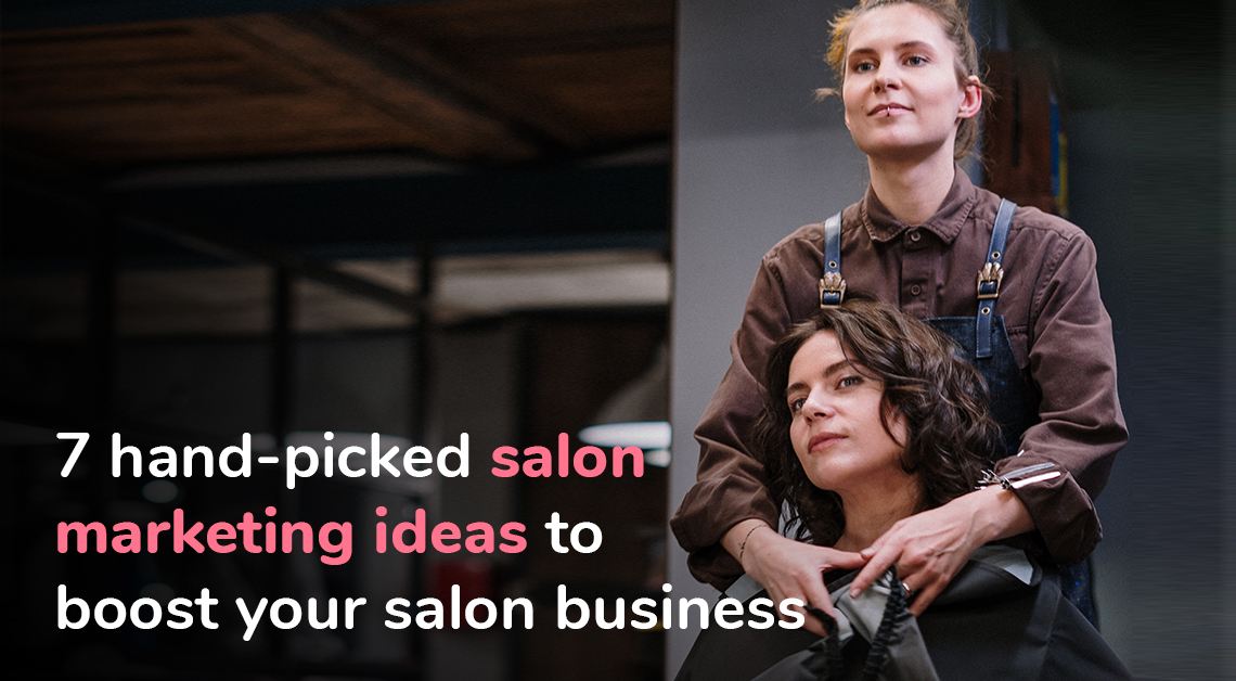 a hairdresser wrapping a black apron around her client before giving her a haircut