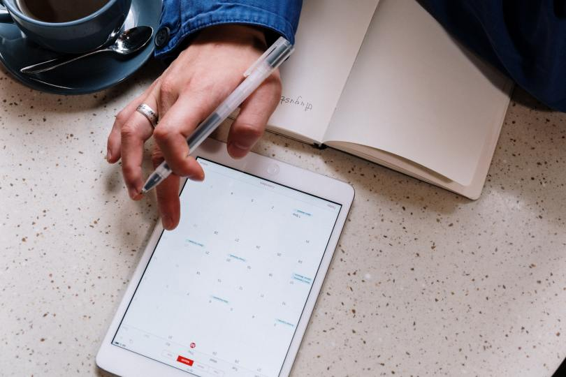 Woman making an appointment online based on the schedule