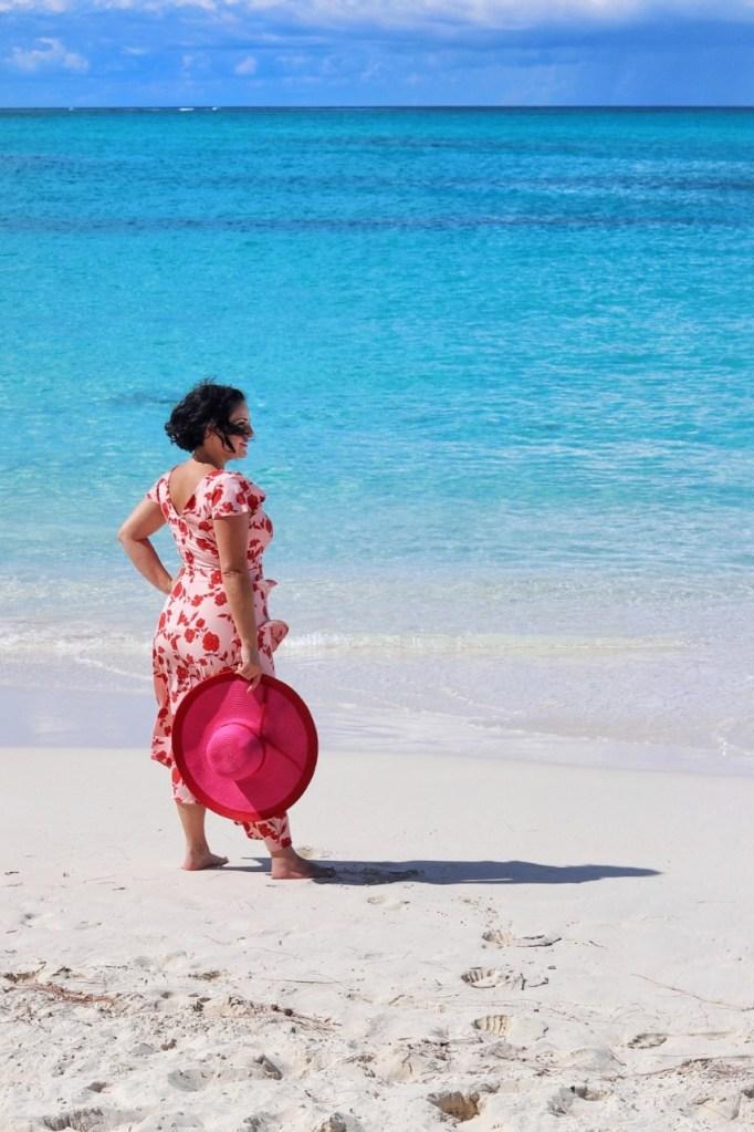 woman at beach wearing sundress sunhat
