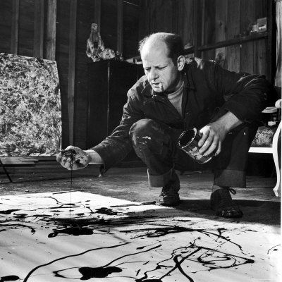 painter-jackson-pollock-working-in-his-studio-cigarette-in-mouth-dropping-paint-onto-canvas-1