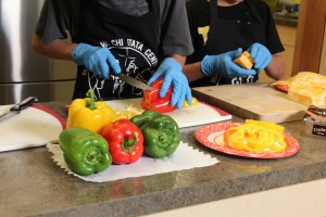Cutting bell peppers for Winnipeg Foundation's Recipe for success