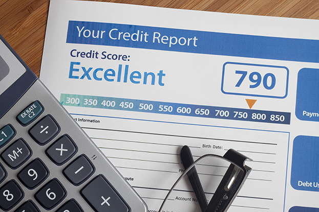 Improve your credit score: Credit report with score on a desk