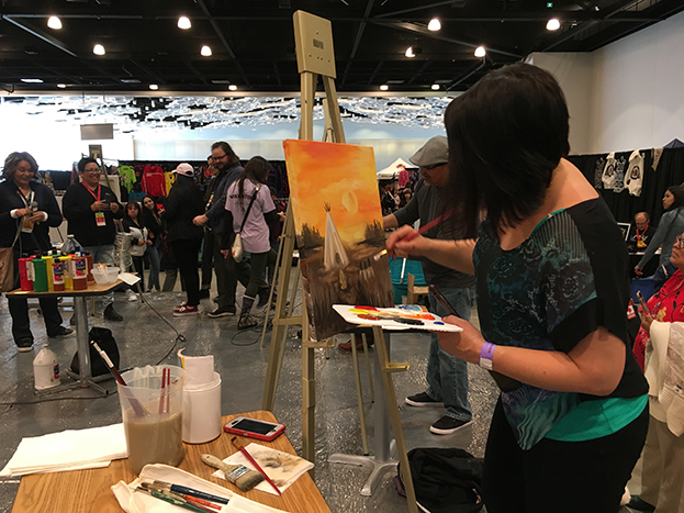 Lisa Delorme Meiler, painting at Manito Ahbee Art Challenge in 2019