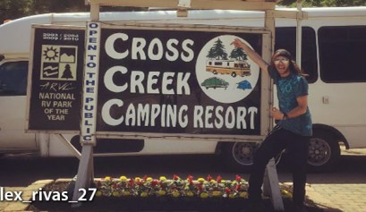 cross creek camping resort, picture of the cross creek camping resort sign with an rv in the background
