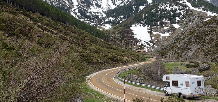 rving blogs, picture of a motorhome driving down a windy road through mountains, 5 rving blogs