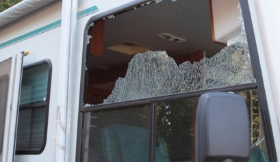 broken rv window, picture of a broken rv window on a motorhome