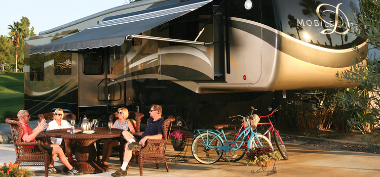 rv full time, picture of a drv mobile suites fifth wheel at a rv site