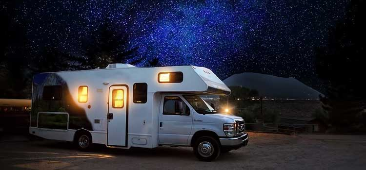 full-time rv life picture of a motorhome sitting under a starry night in the woods