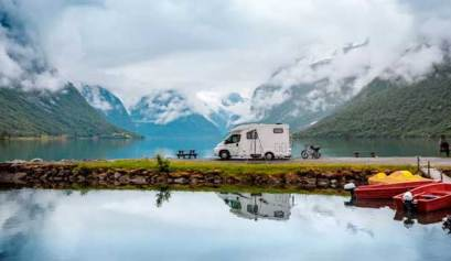 picture of a motorhome on a peninsula with mountains in the background for how to work remotely from your rv