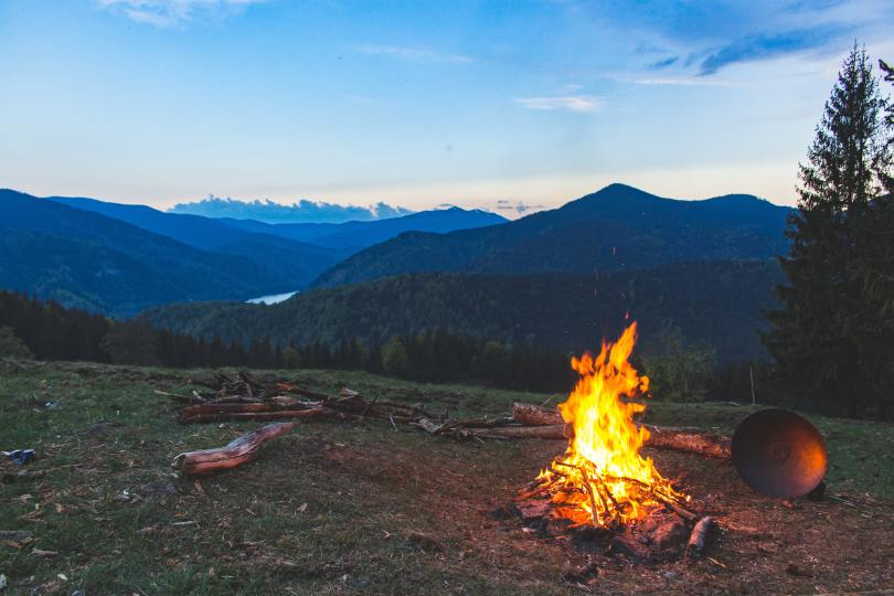 evening campfire looking across valley to snowcapped mountains