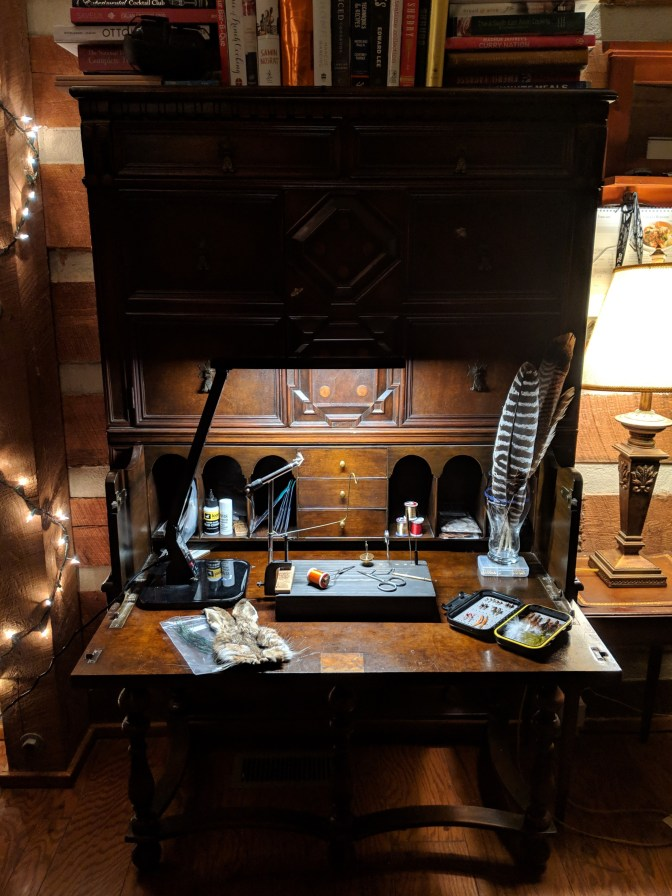 I bought this 19th century English desk at an auction years before I got bitten by the tying bug. With a toddler and 6 year old at home, it's the perfect workstation because it folds up. It's my unwind ritual to sneak downstairs, make a cup of tea and tie flies when everyone else goes to bed. I've only been tying a few months, but it's my new addiction, and this is my happy place.