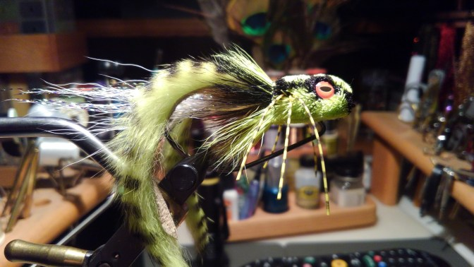 This is the third weedless frog I have tied up with a 3/4 inch shank attached with 25 pound stainless steel wire on an Ahrex 5/0 hook. It takes almost an hour to tie up and trim..