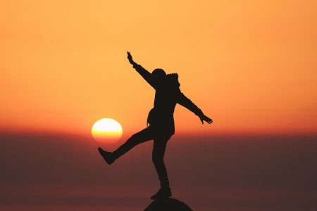 Person posing on a rock