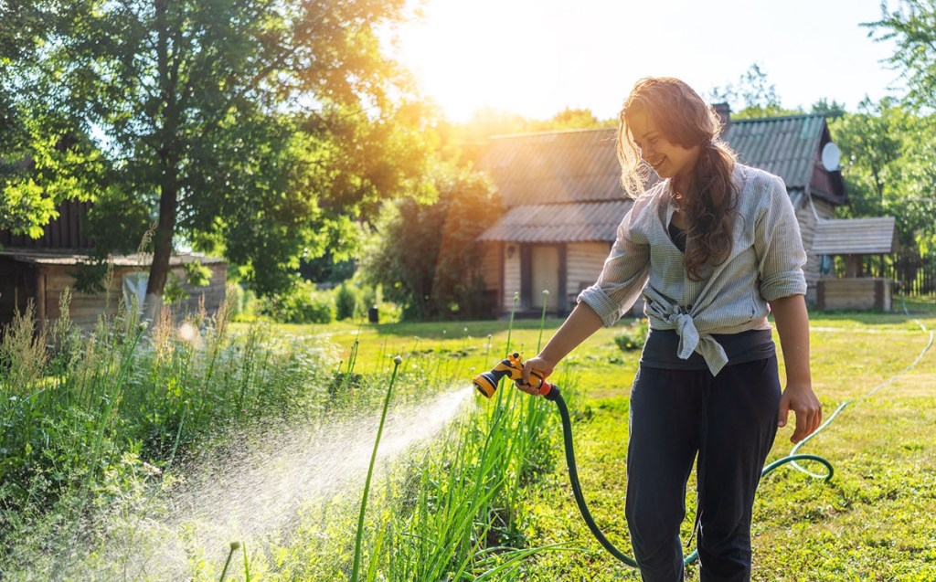Woman watering her home garden