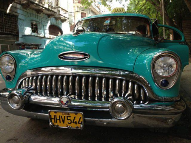 Blue-green antique car in Cuba