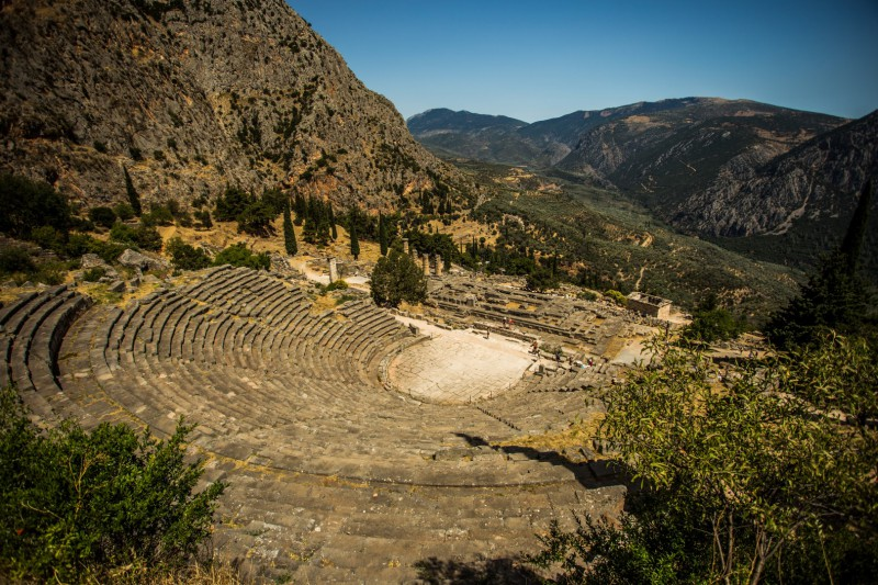 Croatia to Greece road trip, arid landscape with ancient man made ampitheatre