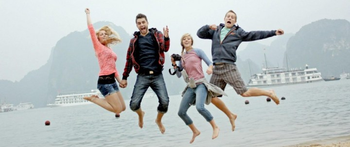 A group of smiling people jumping in happiness