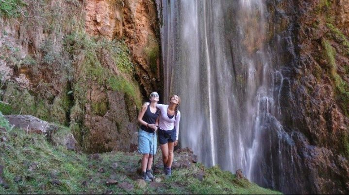 Two amazed friends at a waterfall; Inca Quarry Trek