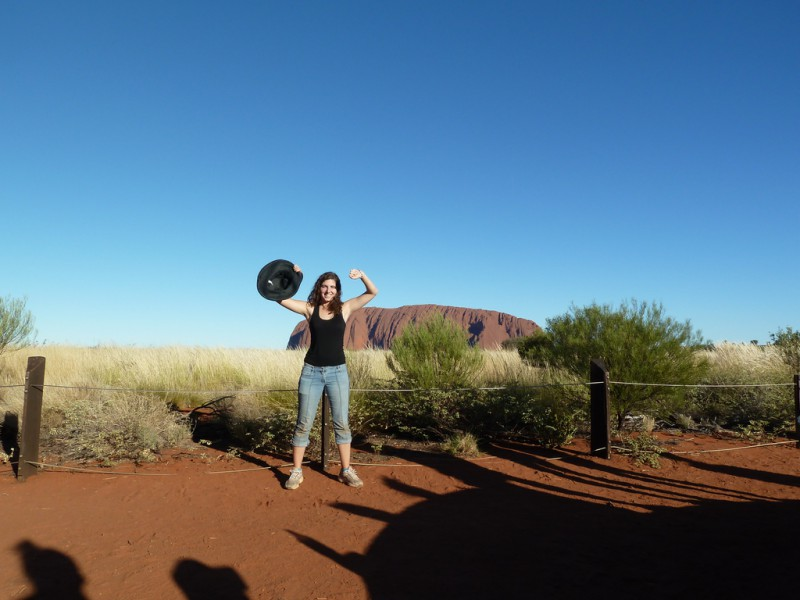 A woman in Front of Uluru
