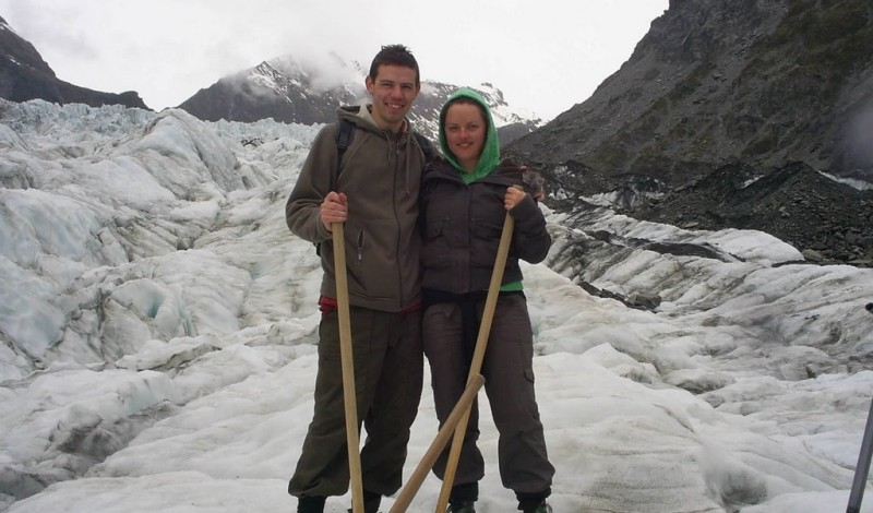 A couple posing on the fox glacier in New Zealand