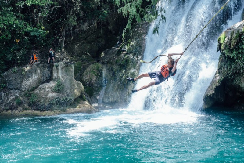 A man swinging in to a river at La Huasteca Potosina.