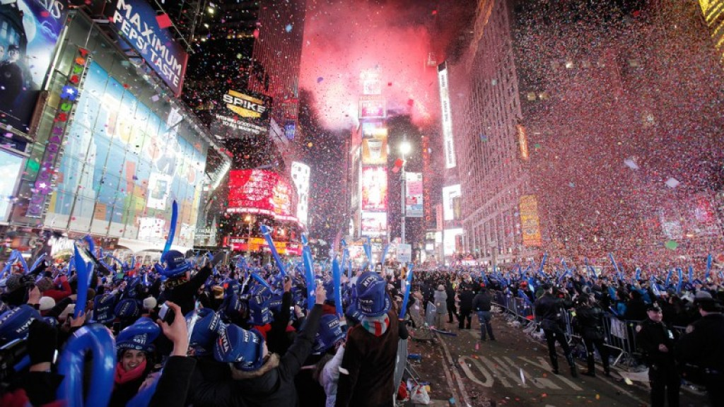 Image: Revellers cheer as confetti falls during New Year celebrations in Times Square in New York