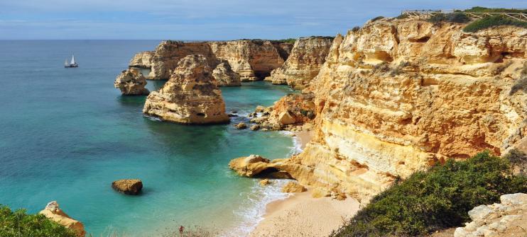 A beautiful clifftop view of Praia da Marinha in Portugal, an underrated beach in Europe