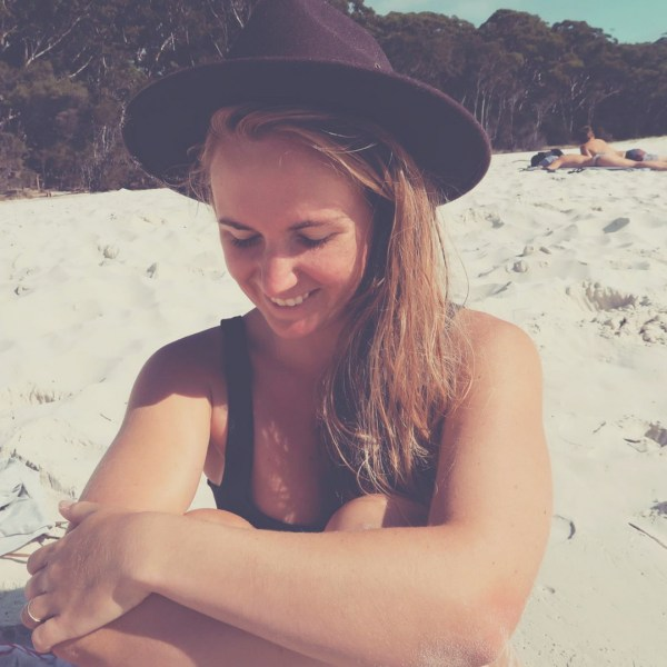 Smiling girl on beach in hat