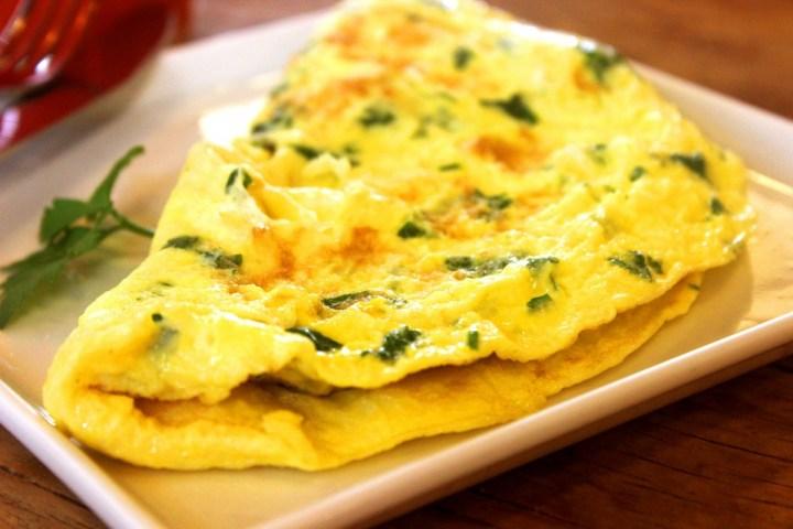 A seasoned omelette on a plate