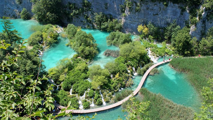 A wooden boardwalk crossing the great green getaway Plitvice Lakes in Croatia