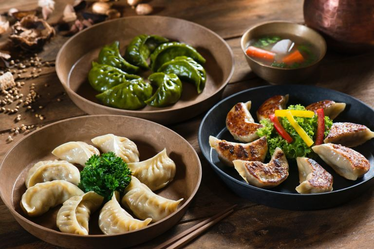 Variety of dumplings and vegetarian dishes