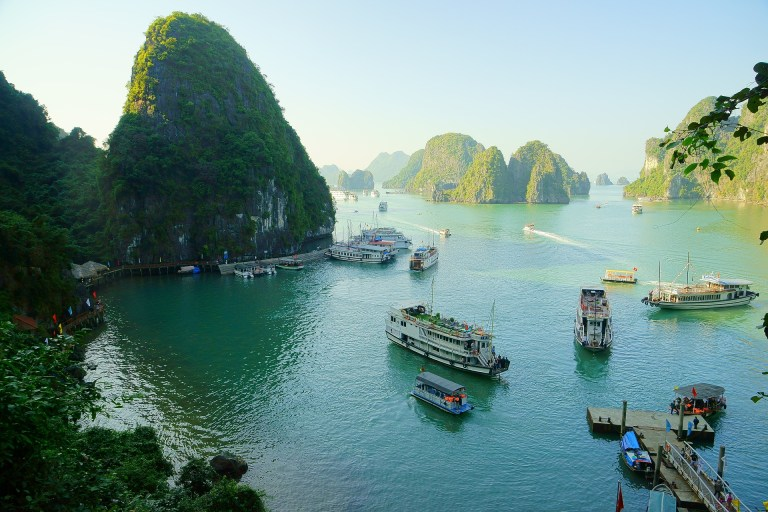 A variety is boats in Halong Bay, Vietnam on a sunny day
