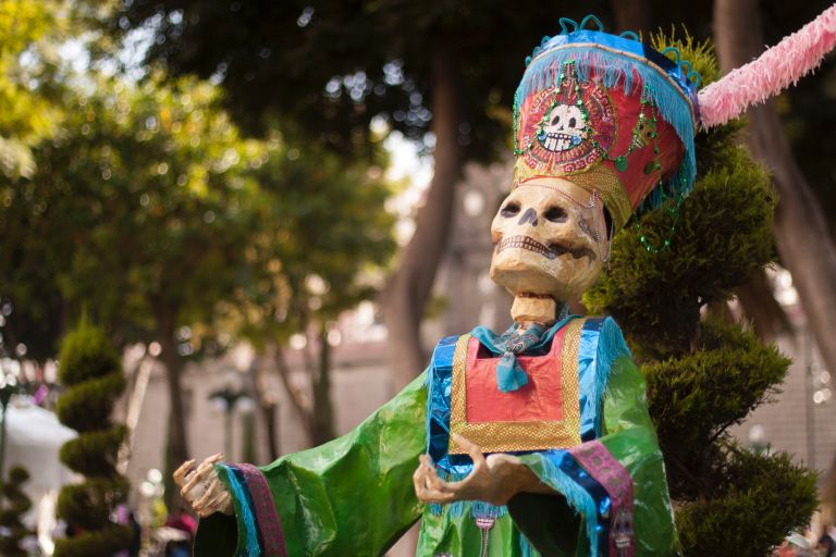 A wooden skeleton in bright clothing in Mexico