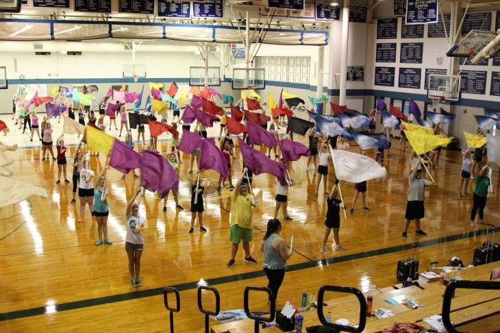 All students warm up with 100 flag spins!